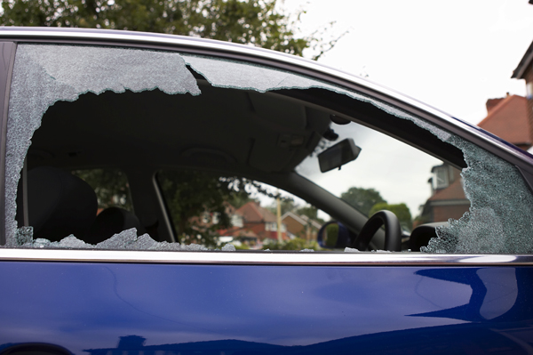 ~1429847257~Smashed safety glass in a car door (window glass) copy