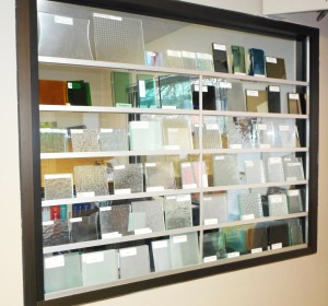 Samples of specialty glass in our showroom. Take one or a couple home or to job site to see what works best for your project!